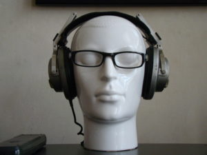 Headphones and glasses on mannequin head