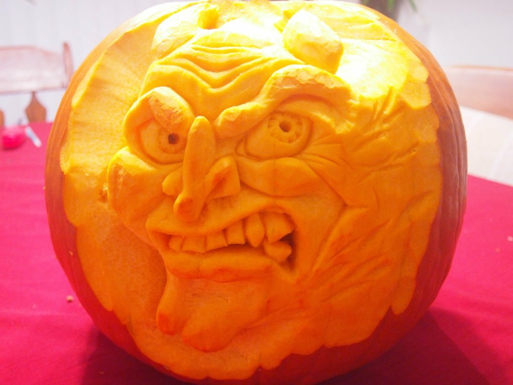 Pumpking with relief carved angry face