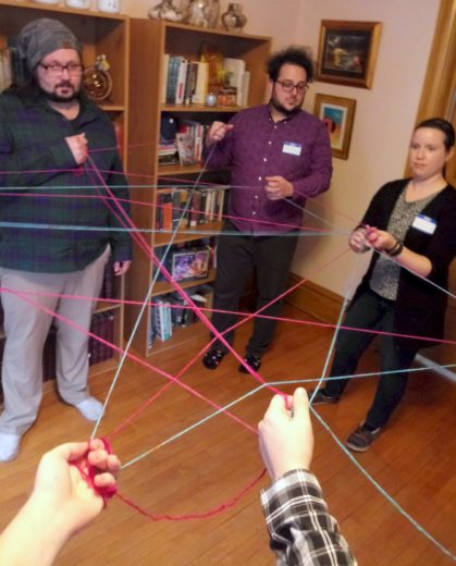 a circle of people connected by a web of yard