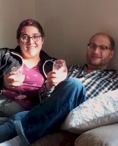 two people with drinks on a beanbag chair