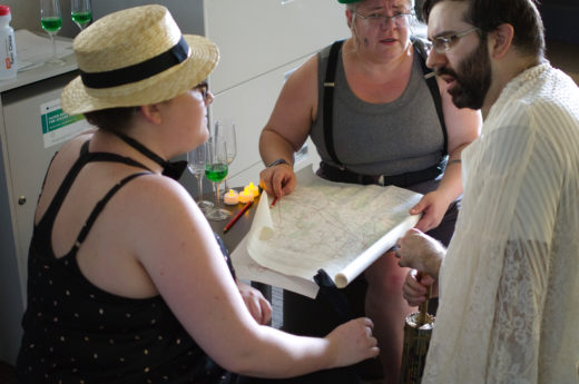 three people discussing over a map