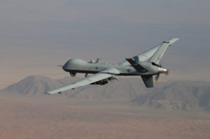 MQ-Q Reaper unmanned aircraft in flight over desert