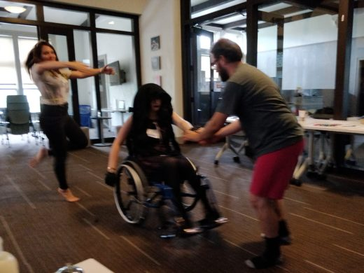 several people dancing, one in wheelchair