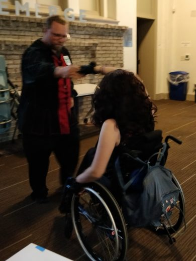 two people, one in wheelchair, dance
